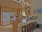 Spacious Kitchen with Gas Range, Breakfast Bar