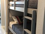 Bunk Beds with Themed Pirates and Ships Sheets.