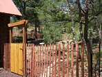 'Official' dog yard! Gate for outside entry, and also inside exit out back patio doors. Shade trees!