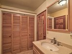 There is a lot of storage space in the bathroom.