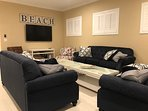 Roomy Living Room offers 3 Sofas, 2 Chair/Ottoman Sets; Plenty of tables - All Brand New!
