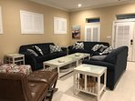 Plenty of comfortable seating in the Living Room.  Plantation Shutters throughout entire home.