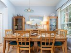 Sit down as a family in the formal dining area that seats eight