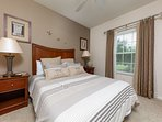 Cozy upstairs bedroom with overhead ceiling fan
