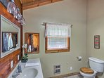 Rinse off the day in this spacious bathroom.