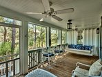 Relax in the swing on this home's beautiful enclosed patio.