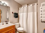 A similar shower/tub combo sits on the lower level's shared bathroom.