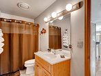 A shower/tub combo adorn this shared bathroom on the main living level.