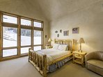 The Master Bedroom is located on the main level of the home and features an en suite bathroom and queen bed.