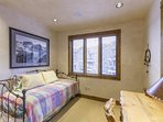 This small twin room is located on the main level and features a twin bed with twin trundle underneath.