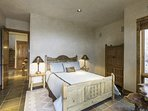 Guest Bedroom 4, like the others, features a queen bed and is located on the first floor.