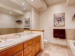 Just down the hall is the upstairs is the shared Guest Bathroom 1, which features a whirlpool tub and separate shower