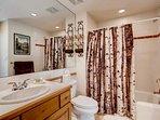 Enjoy a shower or bath in the ensuite bathroom