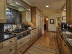 Cook up a delicious dinner on the five burner stove in the kitchen.