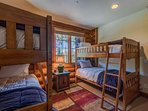 The kids will feel like they're at camp in this bunk room with two twin bunk beds.