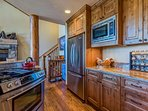 Brand new stainless steel appliances and granite countertops give this cabin its modern feel.