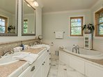There's plenty of space for two in the master bathroom.