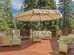 Great views and and oversized umbrella make the back deck perfect for any time of day.