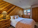 The Queen Guest Room has warm wood paneling and a roomy closet.