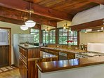 The gourmet kitchen has granite countertops and a large pantry, vintage Wedgewood 4-burner range and oven, stainless...