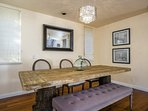 A formal dining area adjacent to living room offers seating for 6 more and some stylish design elements.