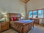 The upstairs master bedroom is home to a king bed, an en-suite bath, and even a telescope for the infinitely curious.