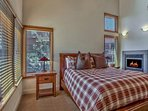The first floor master has both a fireplace and king bed.