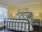 Guest bedroom #3 offers a cheerful, beachy style, California king bed, luxurious linens, and an en-suite bath with...