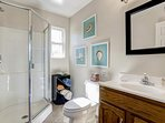 The private bathroom to Guest Bedroom #4 in the second floor apartment has a walk-in shower.