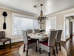 The elegant dining table seats up to 8.