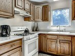 This guest bedroom apartment has a full kitchen, complete with an oven and range stove.