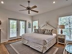 The master bedroom (2nd floor) features a king bed and direct porch access through the french doors