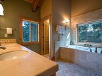 The ensuite Master Bathroom, on the upper floor, features a double vanity and a warm wood and tile design.