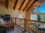 The airy loft overlooks the main living spaces and offers a fine selection of books.