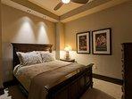 The final guest bedroom has one more queen bed.