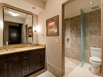This guest's en suite also has dual sinks and a walk-in shower.