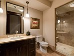 Another spacious shower occupies this guest bathroom.