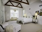 The light and spacious lower level Master Bedroom #1 has french doors leading out to the pool area, king bed, love...