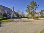 This French country estate and carriage house has a large circular driveway.