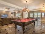 Shoot a quick game of pool downstairs.