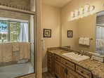 Guest Bathroom #3 on the 1st floor (lower level) is shared by the 3 bedrooms on the lower level and features a jetted...