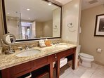 The bathroom features a granite top double vanity and a walk-in shower.
