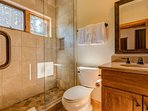 The modern bathroom features a stand-up shower for added convenience.