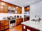 Granite counter tops and stainless steel appliances are a welcome luxury.