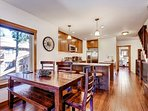 Mountain style dining at the dining table and the kitchen bar. Seating for 10.