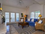 The great room, located on the 3rd level, has a gas fireplace, large plasma TV and DVD player, and a private patio with...