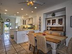 3rd level, Open kitchen and dining room, farm table with seating for 6, fully stocked gourmet kitchen with Viking oven...
