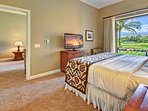 The Master Bedroom has a king bed, a flatscreen TV, direct access to the lanai, and gorgeous mountain views.