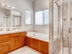 Separate shower and tub in the master en-suite bathroom. Efficient.