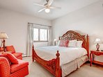 Get a splash of color in this guest bedroom on the lower level, which boasts a king bed and en-suite bathroom.